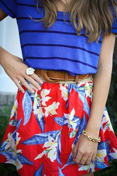 blue striped top with red floral skirt