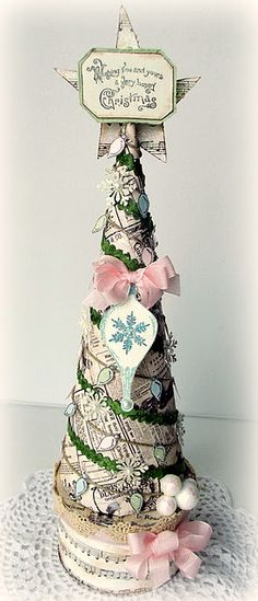 Paper tree, styrofoam base with pretty papers and ribbon...so cute and easy to make