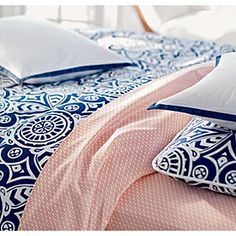 Orangey sheets with navy duvet! Sheets alone are $250 though. Ouch!