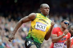 Usain Bolt wins his heat of the men's 200m. YOU'VE GOT TO LOVE HIM