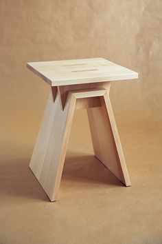 Stool by Dmitry Kutlayev, via Behance has six peaces off wood all slotted together, well maybe the legs are joint by dowels or it could be a lap joint or a miter with wood spline, or just slots in general.