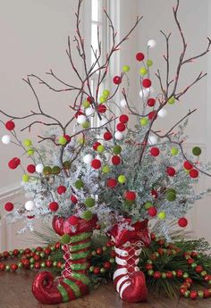 Centerpiece idea from RAZ using Elf Boots, Lighted Branches and Pom Pom Sprays.