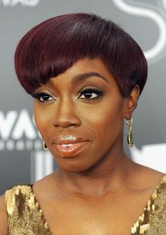 Trendy African American Hairstyles: Short Wedge Haircut from Estelle Swaray. Estelle is a novel, original songstress. So, it only stands to reason that her hairstyle should be more than the average snip of a scissor and of course, its burgundy color is in a class of its own. The right side is left the longest,[Read the Rest]