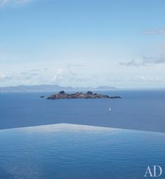 The infinity pool offers views of the surrounding French West Indies | archdigest.com