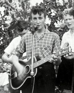 John at the Woolton Church Fete in the summer of 1957 shortly before he met Paul McCartney for the first time ever