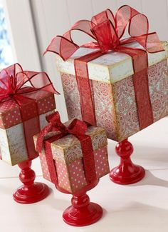 Dollar store boxes, ribbon and candleholders...cheap, pretty centrepiece.
