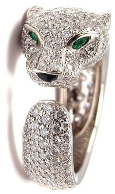 Cartier Panther Onyx Emerald Diamond White Gold Ring. 18k White Gold Panther Diamond, Emerald, and Onyx Ring by Cartier. With 250 brilliant cut paved diamonds, VVS1 clarity E color, emerald eyes, onyx nose. This ring comes with an original Cartier box.