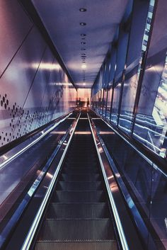 Quiet escalator in a book shop. Remind me of a long tunnel to turn back time.