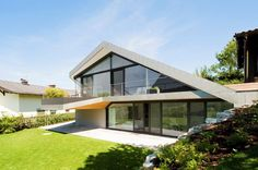 slope roof house with futuristic interiors framing the landscape Slope roof house with futuristic interiors