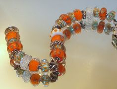 Oranges and Koi Ponds :) From a new member on our Forum!  Thank you for sharing Susan!! http://trollbeadsgalleryforum.ning.com/