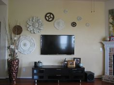 Who would have thought that ceiling medallions would make such an interesting wall collage. Easy project. Just paint and hang.  Check out all of the different patterns that Ekena offers at www.garbes.com