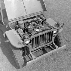 Under the hood of a 1945 MB Willys Jeep. It had handles on the sides, so if need be it could be carried. Funny, concidering it had a ton of power!  It also had headlights with long wires that could be removed and used as flash lights around the vehicle.  And Lot More.  The Hero of WWII