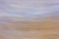 Made in Lecce, Italy, this fine art abstract photograph evokes ethereal feelings of gentle floating. A soft palette of pastel blues and earth tones is arranged in a flowing, horizontal orientation that divides the picture in equal, vertical halves. This minimalist artwork is available as a fine art print in any size and on any material, including mixed media Original on canvas with acrylic embellishing. Please visit NatCoalson.com for a custom quote.