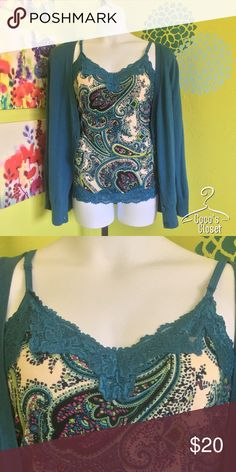 Beautiful lacey cami This cami is in great condition and was worn only a handful of times. Matches perfectly with teal cardigan (sold separately). It features adjustable straps and a longer length for comfort and modesty. Size 14/16 but will comfortably fit up to a size 20. Rayon/spandex blend. PRICE FIRM. Lane Bryant Tops Camisoles