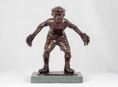 Bronze Sculpture of Children by artist Graham Ibbeson titled: 'Bring it on bronze Boy Playing Football Goalkeeper'