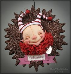Valentine Wumbles-love this...paperclay over apoxie sculpt - to find it, look under Jan 13, 2012, on blog.  Bonehead Studios