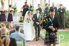 Walking the aisle following bagpipes at an outdoor wedding in Houston.