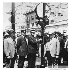 """""""The first electrically operated traffic signal was installed in 1927, at Broadway and Pine Avenue.  On hand for the occasion were Officer Houghton, Chief James Yancy, and City Manager Henry Callahan."""" Long Beach, CA, 1927. For information about copyright and ordering images from the LBPL Digital Archive, see http://www.lbpl.org/history."""
