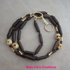 Skull Brown Wood and Gold Beaded Lanyard by missvalscreations