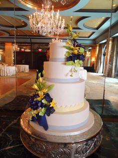TIER Luxury Cakes: an elegant purple and yellow wedding cake with custom designed sugar flowers.
