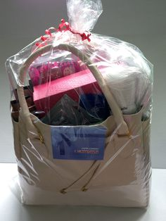 Tote bag with gift card, assorted hair and bath products, ear phones, gift box and more.  Donated by: Pharmacie Jean Coutu (Lennoxville) _________________ Sac fourre-tout avec carte-cadeau, cheveux et produits de bain assortis, des écouteurs, boîte-cadeau et plus.  Donné par: Pharmacie Jean Coutu (Lennoxville) Silent Auction, Tote Bag, Tote Purse, Pharmacy, Products, Hair, Carry Bag, Tote Bags