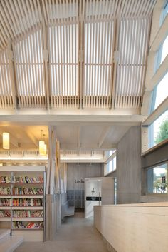 The public library is part of a public-private initiative taken to rebuild Constitución after the degrees earthquake and Tsunami that devastated the town during the year Earthquake And Tsunami, Public Space Design, Interior Architecture, Interior Design, Wooden Buildings, Gallery, Home Decor, Ceilings, School Stuff