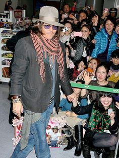 FAN MALE  After playing fan to Vanessa Paradis, Johnny Depp gets a fan-frenzied reception of his own Wednesday at Narita International Airport in Chiba, Japan. Credit: Jun Sato/WireImage  Published: Wednesday Mar 02, 2011 | 05:00 PM EST