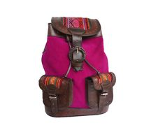 This handmade magenta backpack is made in Los Altos, Bolivia. The color magenta is one of universal harmony and emotional balance. It is spiritual yet practical, encouraging common sense and a balanced outlook on life.  This is a color that helps to create harmony and balance in every aspect of life; physically, mentally, emotionally and spiritually.   - 100% Leather/ Suede - Body: Magenta  - Apprx Body Dimensions: 10.25 x 13 - Apprx Strap Dimensions: 1 x 30 (adjustable straps)