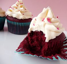 Red Velvet Cupcakes the perfect combination moist, fluffy, a tiny bit chocolatey, topped with a heaping pile of cream cheese frosting!