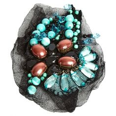 Costume brooch in black tulle embellished with turquoise and glossy brown pearls in different shapes.nNo case or original pouch.