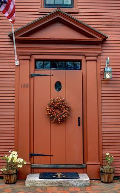 Beautiful Decorated Brown Door (c) Laura Duhaime Photography Holidays are a very festive time of the year. One beautiful way to welcome people to your home is to decorate your front door. This colonial house in the historical district of Strawberry Banks had one of these decorated doors. This is a beautiful scenic area in New Hampshire.