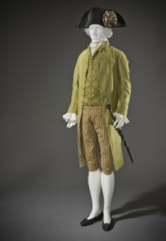 Formal 3-piece suit, France, c. 1790. Green silk taffeta; waistcoat: green silk velvet with floral motifs. Note the tricolor cockade on the hat.