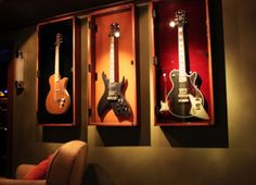 I really want a guitar like the one in the middle!! So metal and so beautiful. It cost a lot though
