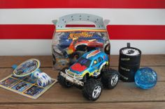 Monster truck party favors including a glitter bouncy ball, monster truck stickers, a wheel yo yo, and a barrel-o-slime! #BirthdayExpress #CraftThatParty