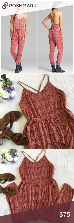"""Free People sunset open back romper with pockets Breezy and light bodysuit/ romper from Free People in a funky ikat like print. """"Tomato"""" color with a drawstring waist, low back, adjustable criss cross straps, and best of all, pockets! Super cute and ready for your summer wardrobe! Wear with a top underneath or bralette! Perfect for festival season, or any other occasion. Excellent condition, no flaws. Size Large. Free People Pants Jumpsuits & Rompers"""