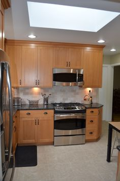 Here Is A Recent Kitchen By Majestic Kitchens U0026 Bath Designer Roberto  Leira. Cabinetry   Cabico 600 Door Style In Maple With An Old Royal Finish.