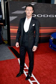 Luke Evans in A.Sauvage black three-piece tuxedo. #suits