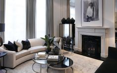 Curved sofa, mirrored cabinet, perfectly monochromatic.
