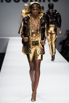 Moschino | Fall/Winter 2014 Ready-to-Wear Collection via Jeremy Scott | Modeled by Leomie Anderson | February 20, 2014; Milan, Italy