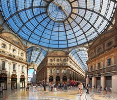 Galleria Vittorio Emanuele II Completed in 1877 by architect Giuseppe Mengoni, Galleria Vittorio Emanuele II is one of the oldest and most luxurious shopping centers in the world, occupying an ornate glass-roofed double arcade in central Milan.
