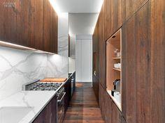 White oak cabinetry contrasts with honed Calacatta gold marble in this Manhattan factory loft kitchen by Messana O'Rorke. Loft Kitchen, Kitchen Dinning, Kitchen On A Budget, Kitchen And Bath, Kitchen Ideas, Dining Table, Baths Interior, Kitchen Interior, Kitchen Design