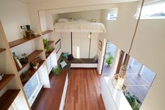A 193 sq ft tiny house Built in Brisbane, Australia with a remote controlled retractable bed and modular deck system that can be dismantled in an hour or two. Tiny House Company, Tiny House Swoon, Modern Tiny House, Tiny House Living, Living At Home, Tiny House On Wheels, Tiny House Design, Living Room, Earthship