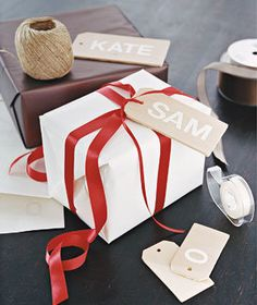 Craft-store project: Personalize wooden tags with stick-on letters. | Find 24 creative ideas to make your wrapping as special as the gift itself.