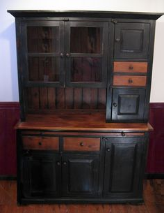 The contrasting colors of this 2-tone Hoosier cabinet draw the eye to the special details.  We use wood from dismantled barns and log homes dating from the 1800's to early 1900's to create rustic, one-of-a-kind, reclaimed barn wood furniture, in the heart of Amish Country, Lancaster, PA. Custom orders are our specialty. Visit our showroom located in Intercourse, PA. www.braunfarmtables.com