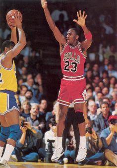 Michael Jordan guarding Magic Johnson