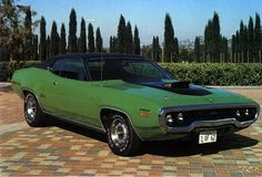 1971 Plymouth GTX. These cars could move. Mu husband's was gold and went to California, wish we had back.