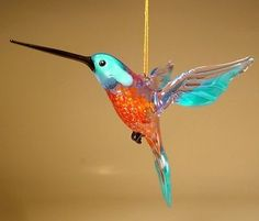 Beautiful Handmade Blown Glass Blue Hummingbird Ornament Size: L - in H - in W - in All items will be shipped next business day by USPS Class Mail insured. Red Glass, Glass Art, Glass Figurines, Glass Birds, Hummingbird, Glass Bottles, Blue Yellow, Artisan, Ornaments