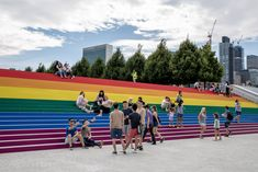 """Graphic designer Fallon Kesicier has installed New York's """"largest Pride flag"""" on the steps of the Louis Kahn-designed Four Freedoms State Park to celebrate Pride Month. Four Freedoms, Stonewall Riots, Roosevelt Island, Louis Kahn, Classical Architecture, Landscape Architecture, Lebbeus Woods, Park In New York, Old Abandoned Houses"""