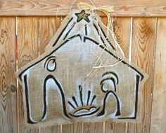 Always remember the reason for the season! Welcome holiday guests with this stylized version of the holy family. Made from burlap and acrylic paint.