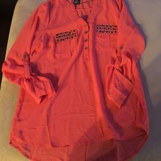 Orange blouse with front pockets I think I wore it once. Orange isn't my color. Metal detailing on front pockets. Thin material but not see through. Says 1x but fits like an xl Roll up sleeves great for summer. Color is reddish orange. Tops Tunics